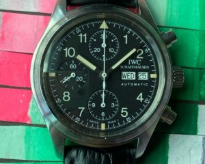 Brand: IWC Reference: IW3706; 3706 Model: Pilot Spitfire Automatic Chronograph 3706 Black Dial Size : Men (39mm) Function: Day, Date, Chronograph Case: Stainless Steel Movement : Mechanical Automatic Condition: 90% Remarks: No Box & No Warranty Papers,Black Strap is non-original, Patina T Dial , Extra Non-Original Buckle & Hermes Style Strap